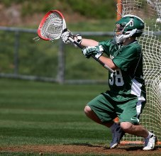 lacrosse goalie stopping ball