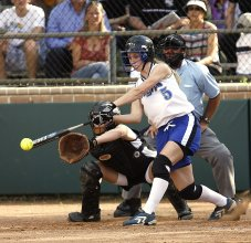 softball player hitting