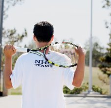 student holding tennis racket
