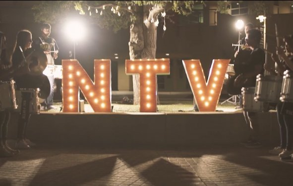 NTV sign with students